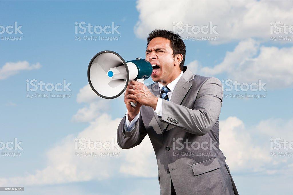 Businessman Yelling in Megaphone royalty-free stock photo