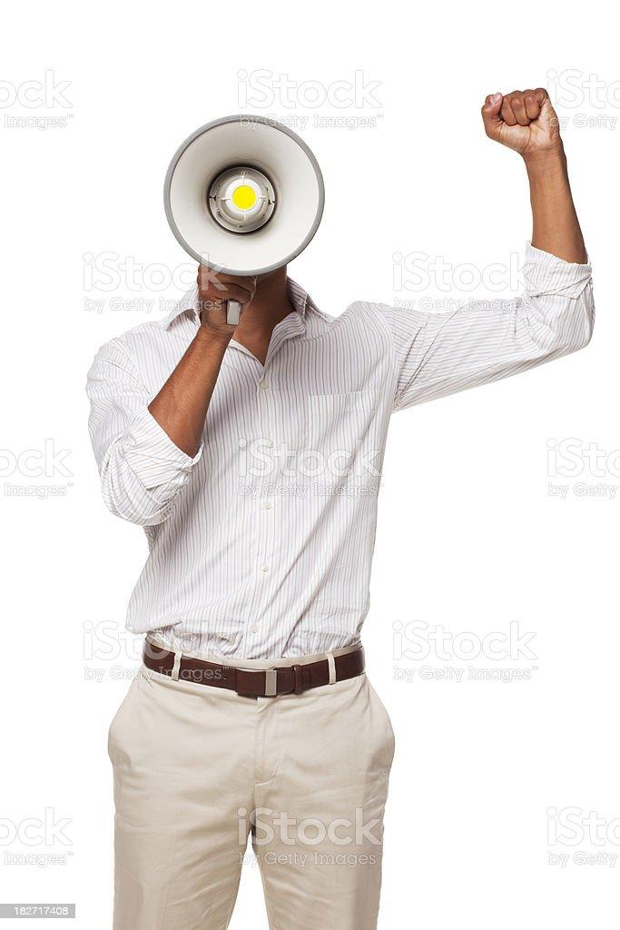 Businessman Yelling Through Megaphone. Isolated royalty-free stock photo