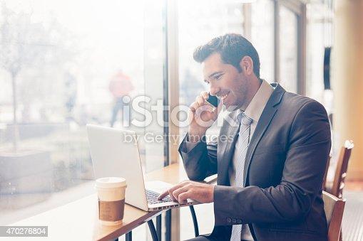 BusinessmanHaving a coffee break and using a computerBusinessmanHaving a coffee break and using a computer