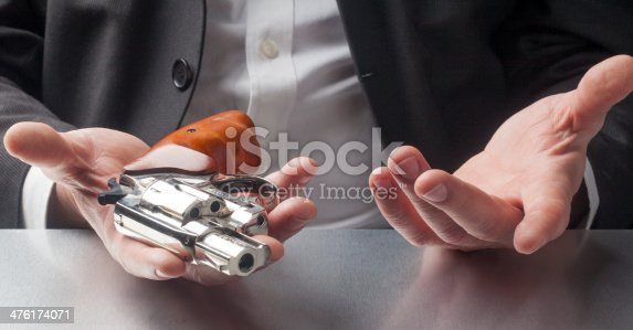 istock businessman's giving up with violence 476174071
