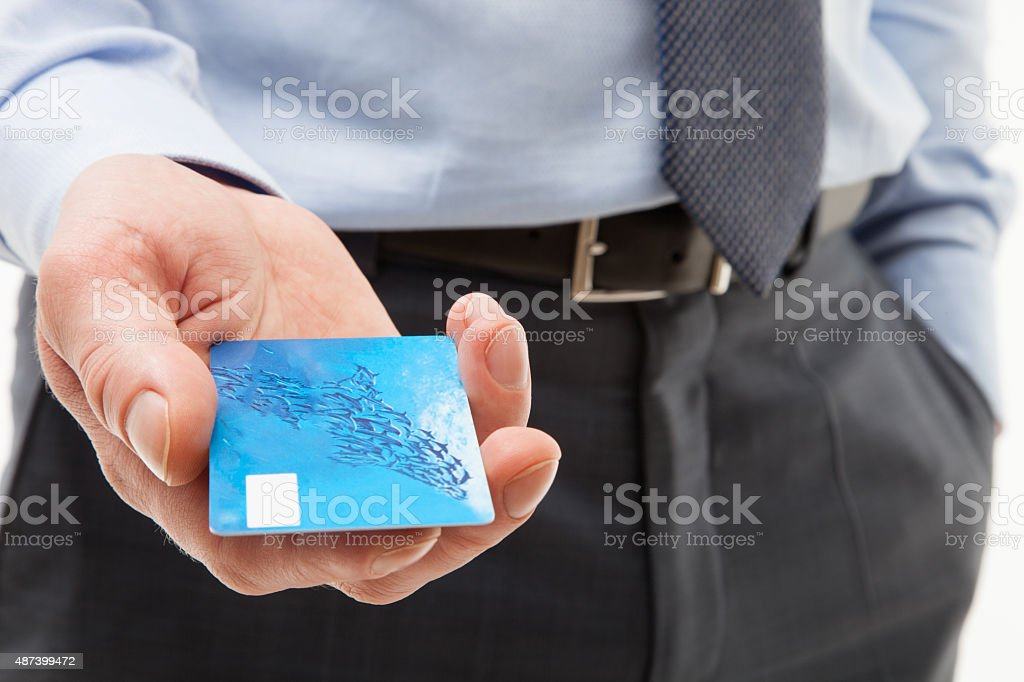 Businessman's hand giving credit card stock photo