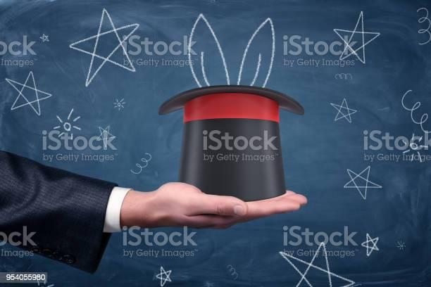 Businessmans hand holding a magicians hat with chalk drawn rabbit picture id954055980?b=1&k=6&m=954055980&s=612x612&h=2srki2kauhsfgma5upsngjr7ie7dxq0rau39avmcsoo=