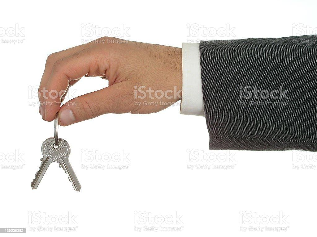 Businessman's Hand Holding Keys royalty-free stock photo