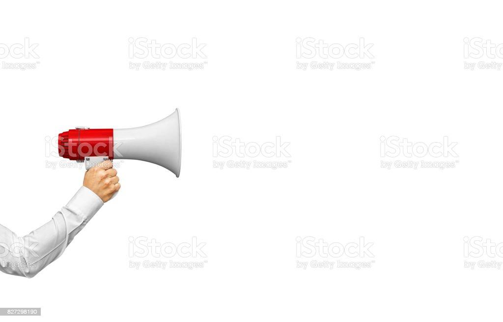 Businessman's hand holding megaphone stock photo