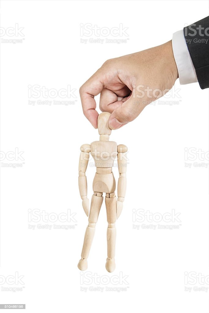 Businessman's hand holding wooden figure, isolated on white background stock photo