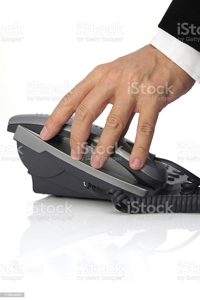 businessman's hand is picking up headset stock photo