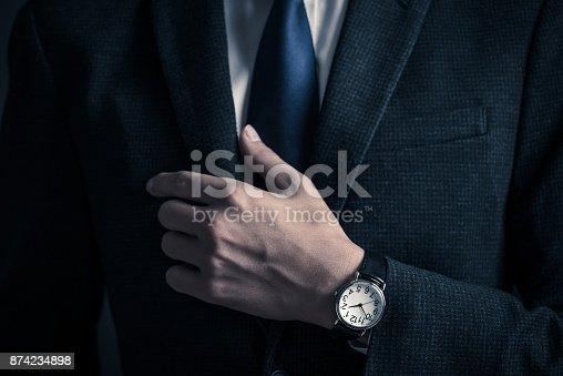istock Businessman's hand 874234898
