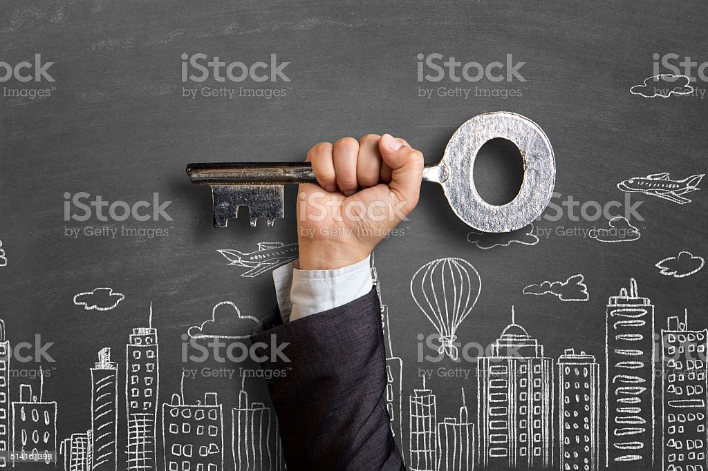 Businessman's hand showing a large key stock photo