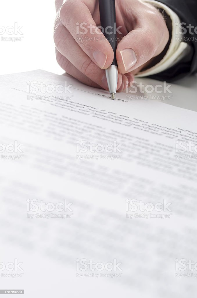 Businessman's hand signing a contract royalty-free stock photo