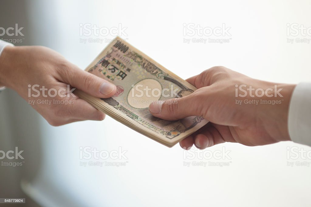 Businessman's hand that presents bank notes stock photo
