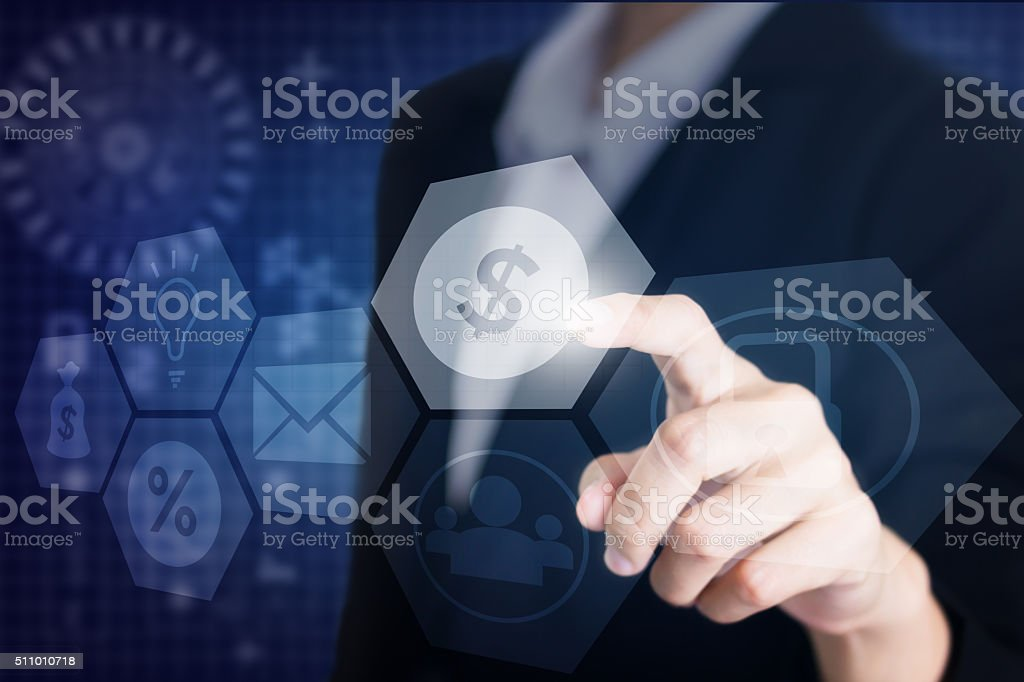 Businessman's hand touching the screen the symbol financial. stock photo