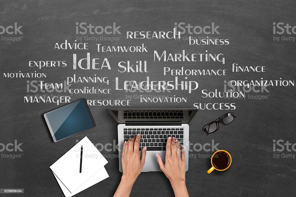 Businessman's hand using laptop with word cloud stock photo