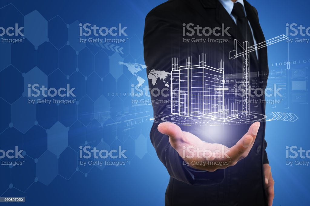 Businessman's hand with building construction design reality virtual technology. Building automation digital wireless control concept. stock photo