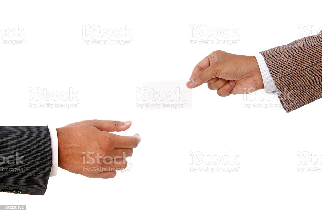 Businessman's hands giving business card stock photo