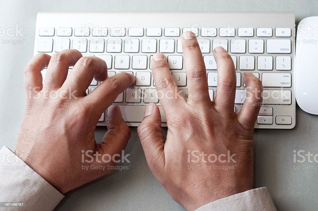 Businessman's hands working on computer royalty-free stock photo