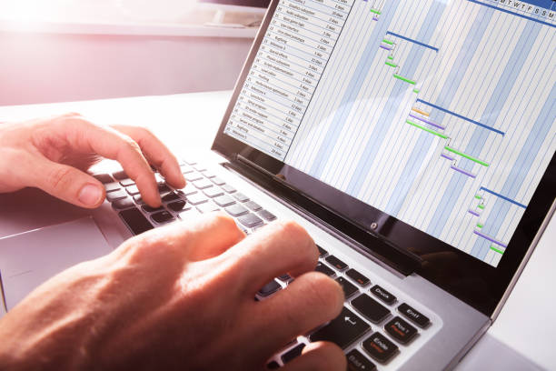 businessman's hands working on gantt chart on laptop - timeline стоковые фото и изображения