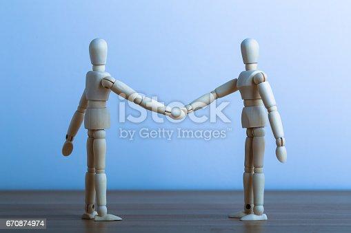 istock Businessmans Handshake 670874974