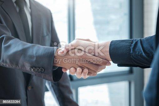 istock Businessmans handshake. 865833094
