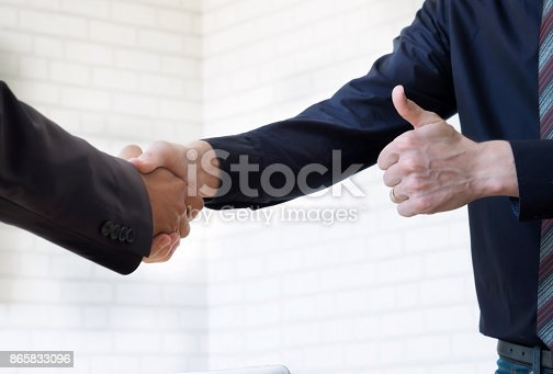 istock Businessmans handshake. 865833096