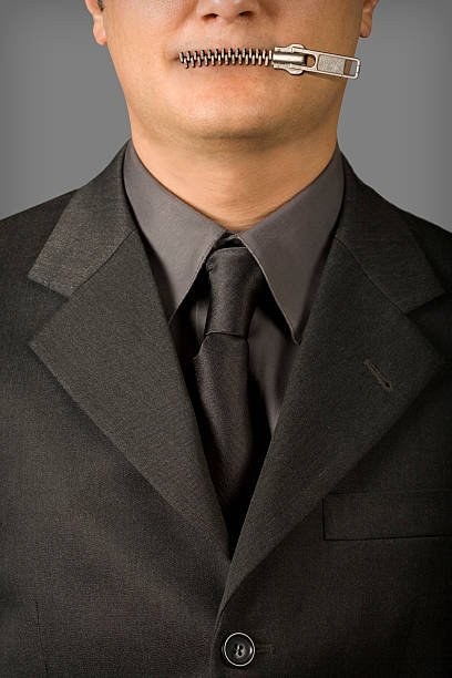 Businessman's Mouth with Zipper stock photo