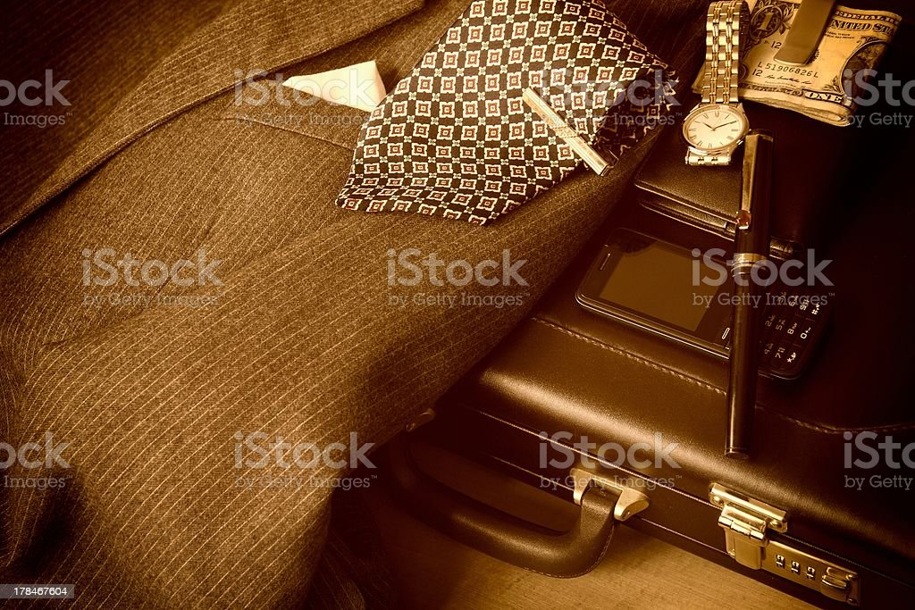 Businessman's suit and accessories in sepia tone stock photo