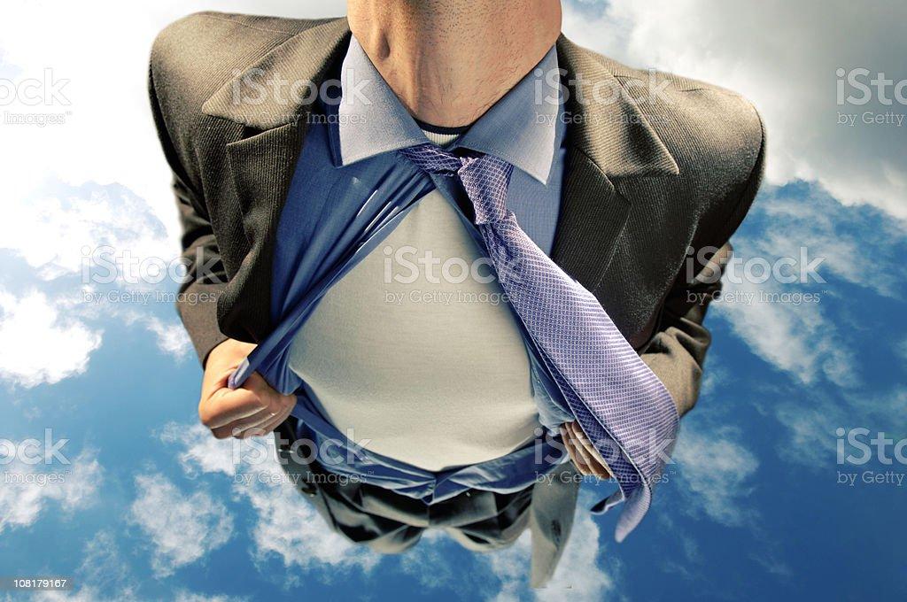 Businessman/Superhero Flying Through Sky stock photo