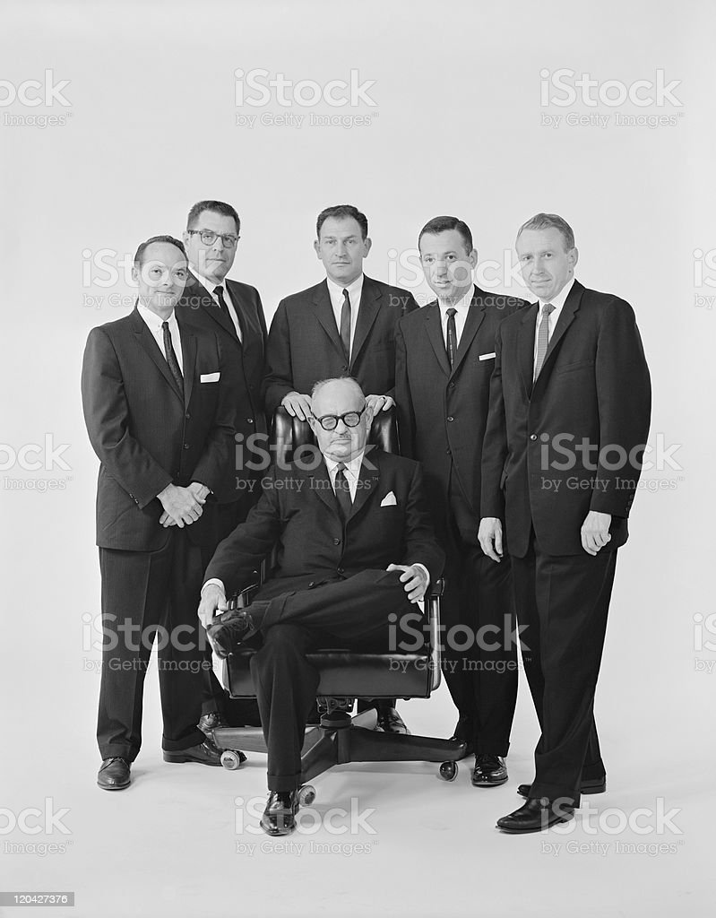 Businessmen against white background, portrait stock photo