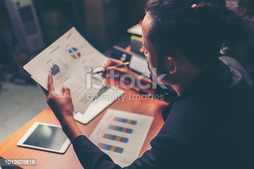 1024730528 istock photo Businessmen are analyzed data from report using smartphone and laptop computer. 1013625816