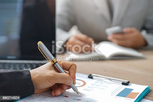 istock Businessmen are analyzing the investment. 890214524