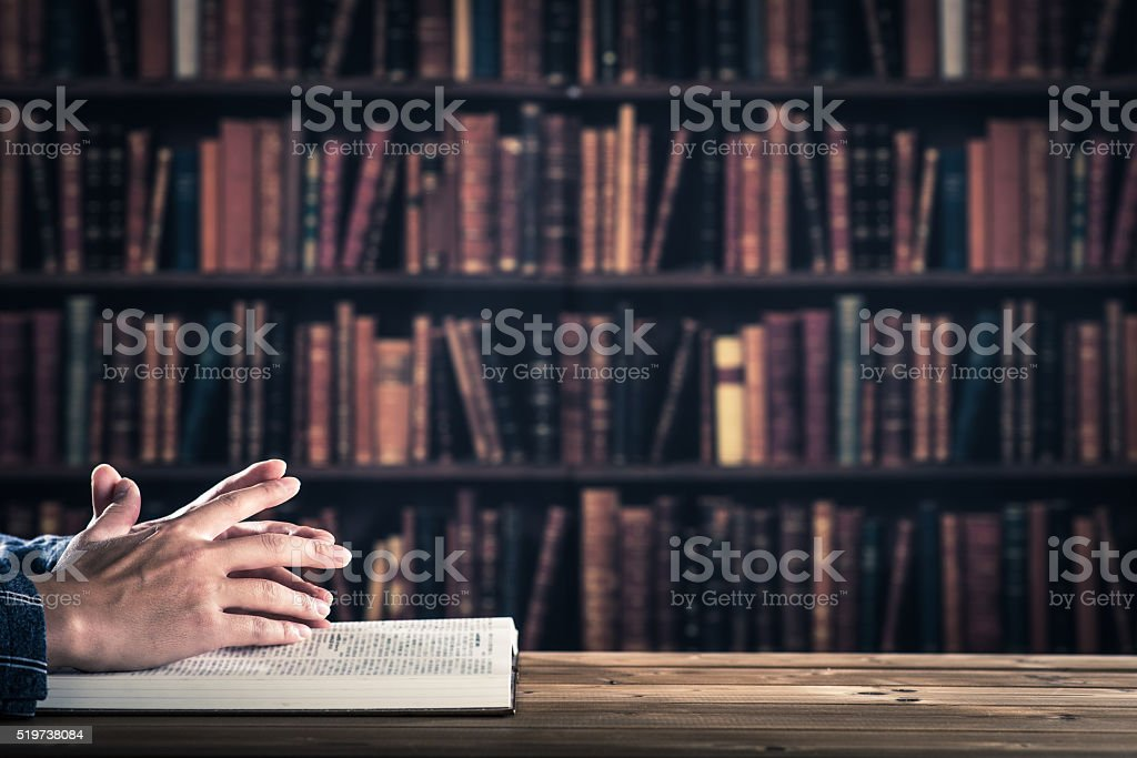 Businessmen are reading a book, body parts stock photo