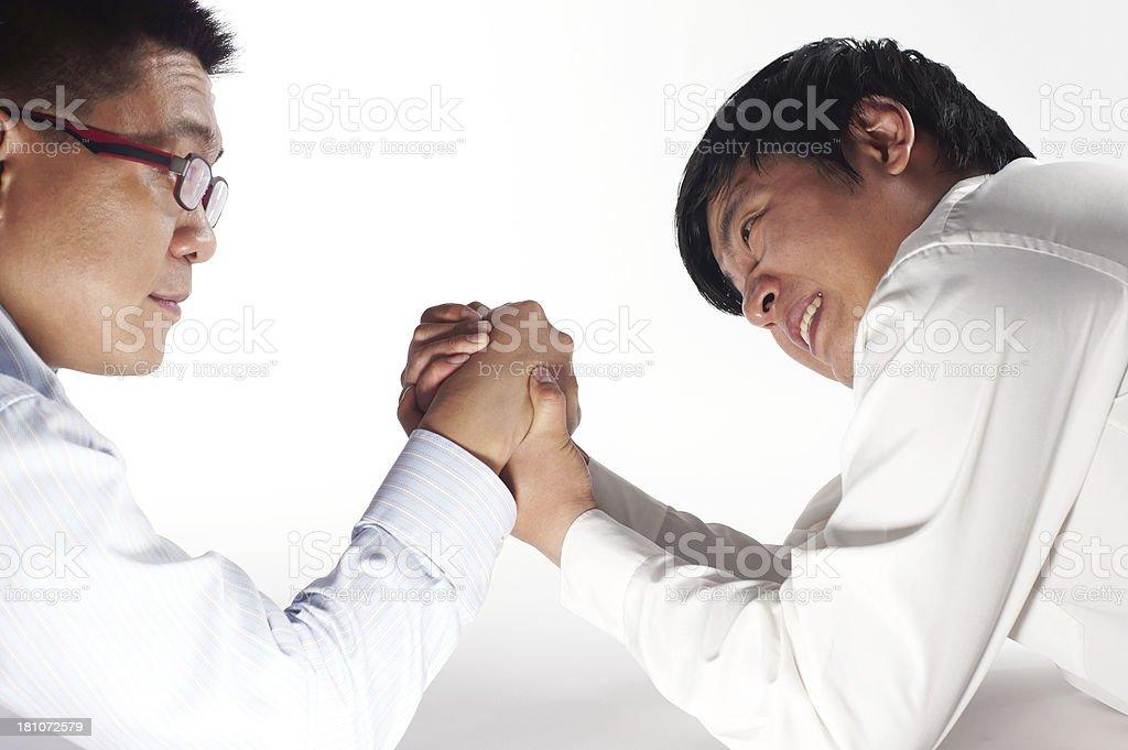 Businessmen Arm Wrestling royalty-free stock photo