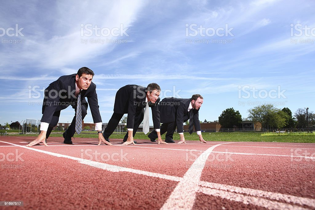Businessmen as track starting line stock photo