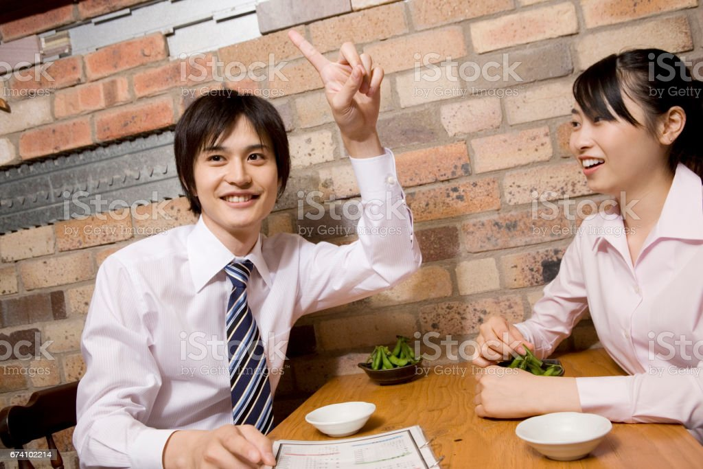 Businessmen at the tavern to order royalty-free stock photo