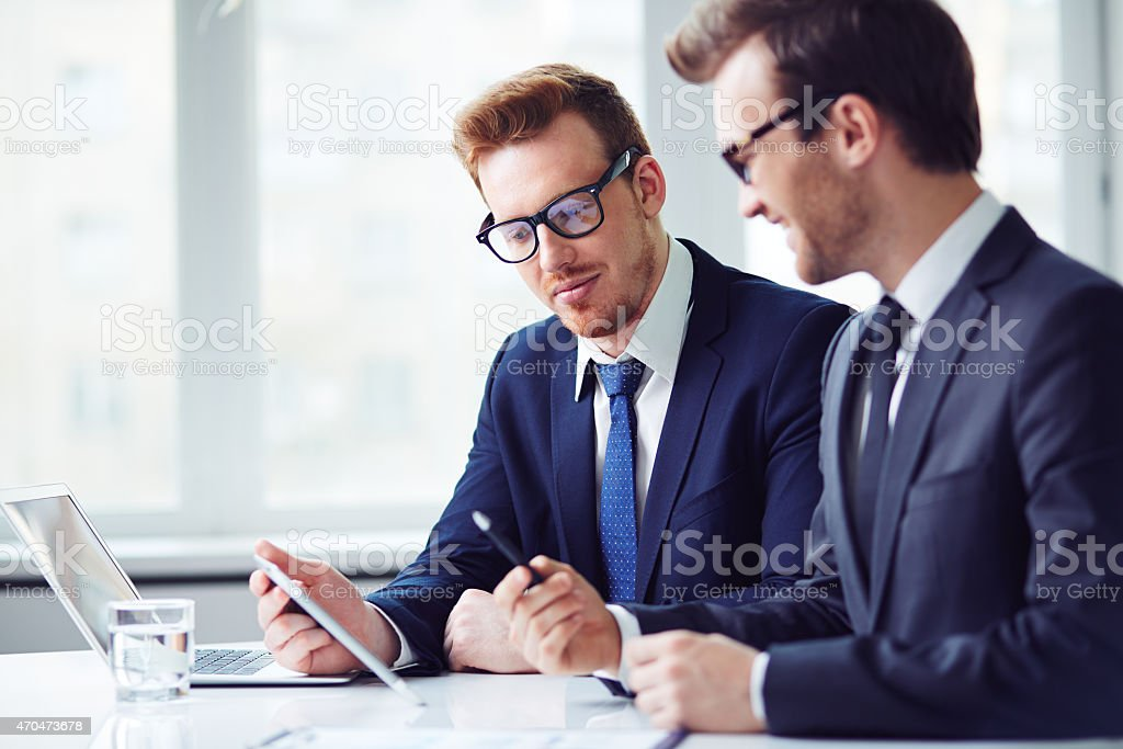 Businessmen at work stock photo