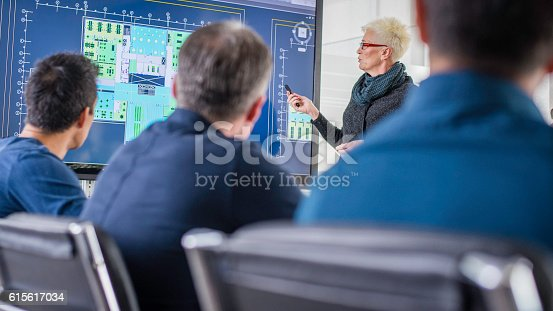 istock Businessmen attending an architecture seminar 615617034