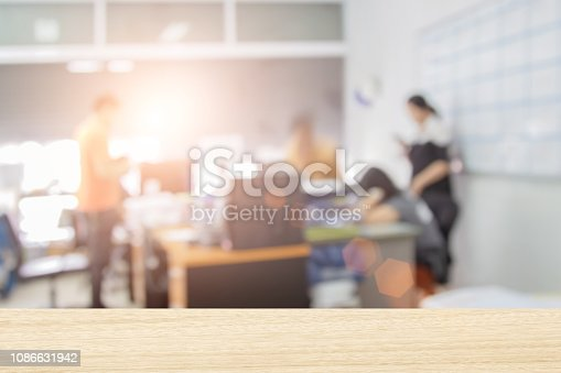 879125330 istock photo Businessmen blur in the workplace or work space of laptop on table in office room with computer or shallow depth of focus of abstract background. - Image 1086631942