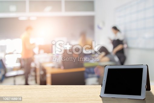 879125330 istock photo Businessmen blur in the workplace or work space of laptop on table in office room with computer or shallow depth of focus of abstract background. - Image 1092168916