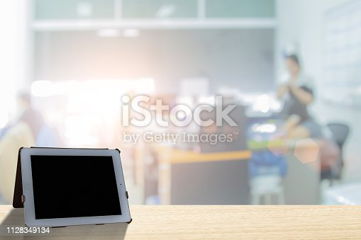 879125330 istock photo Businessmen blur in the workplace or work space of laptop on table in office room with computer or shallow depth of focus of abstract background. - Image 1128349134