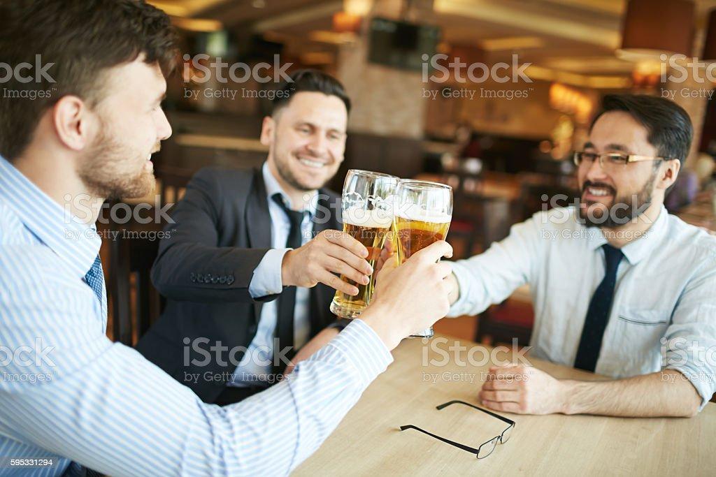 Businessmen celebrating stock photo