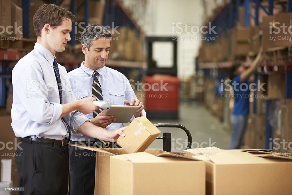 Businessmen Checking Boxes With Digital Tablet royalty-free stock photo