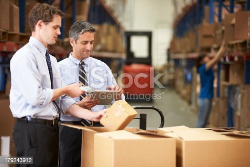 istock Businessmen Checking Boxes With Digital Tablet 179243912