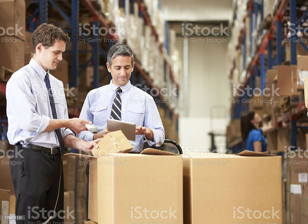 Businessmen Checking Boxes With Digital Tablet stock photo