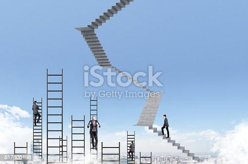 istock Businessmen climbing upstairs 517805198