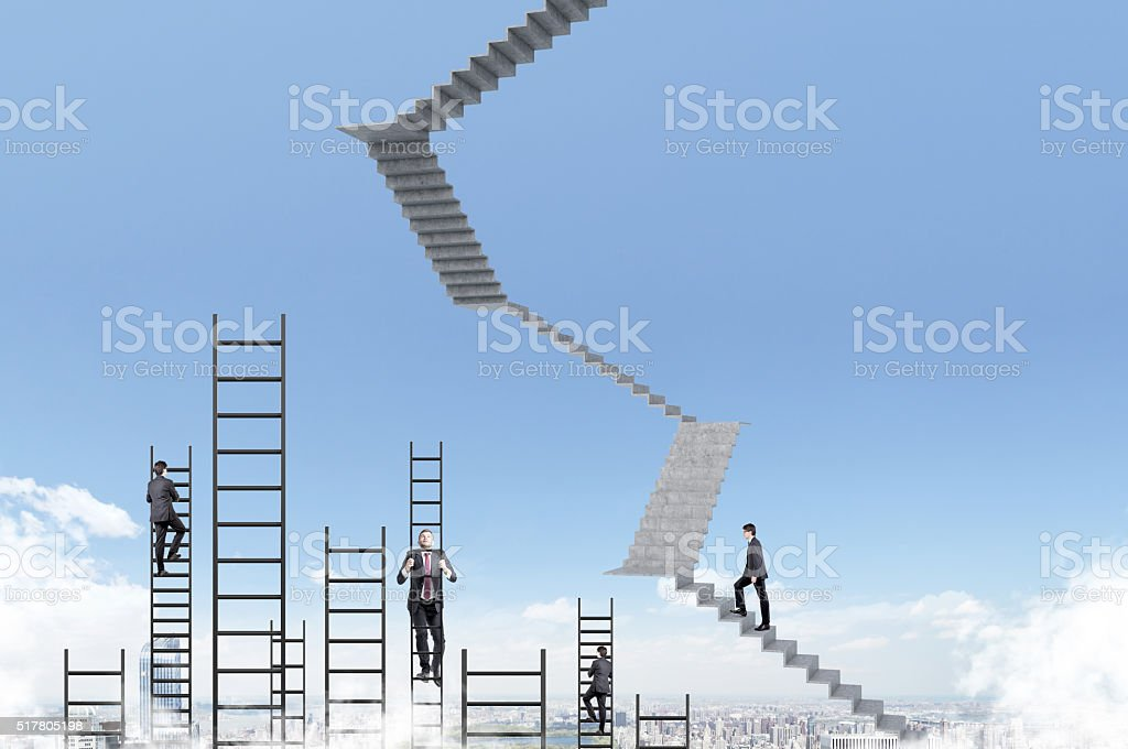 Businessmen climbing upstairs stock photo