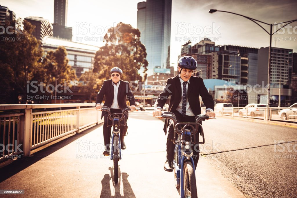 businessmen commuting on the city in melbourne at dusk stock photo