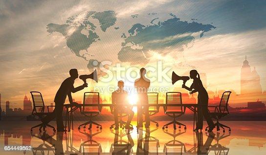 istock Businessmen conflict with megaphones 654449862