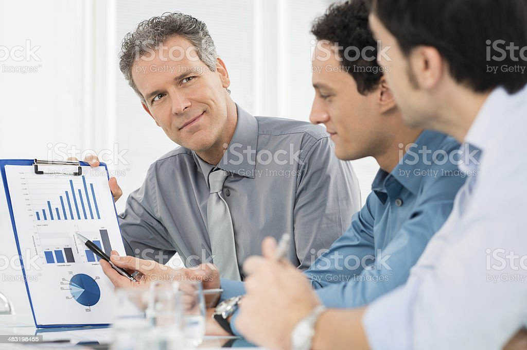 Businessmen Discussing Graph stock photo