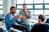 istock Businessmen discussing in creative office 628505836
