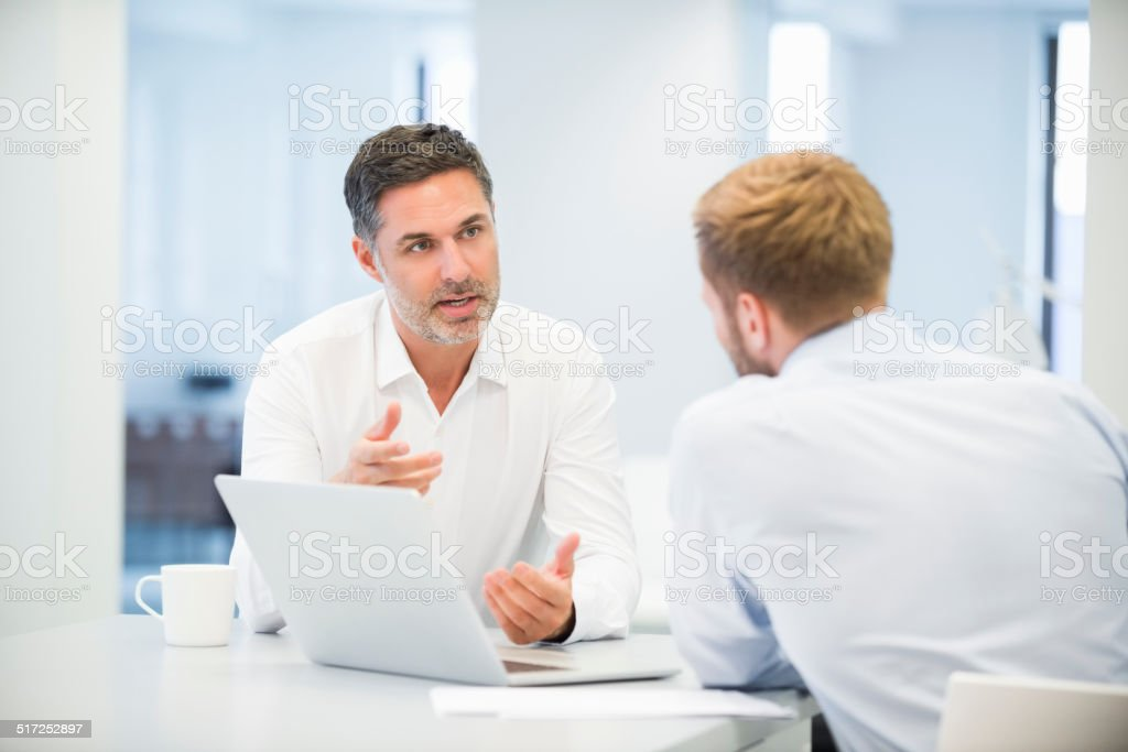 Businessmen Discussing In Office stock photo