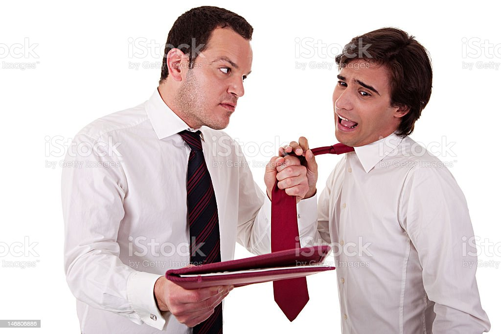 businessmen discussing, pointing to a document and pull the tie royalty-free stock photo